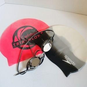 2 swim caps and goggles